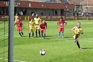 Aiden Chippendale scores Colne's third from the penalty spot against Droylsden