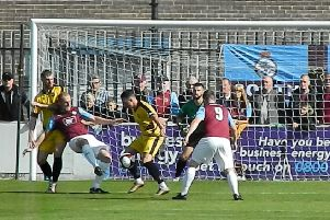 Colne defend their goal at South Shields in the first meeting on Saturday