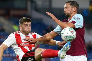BURNLEY, ENGLAND - AUGUST 28: Daniel Drinkwater of Burnley and Lynden Gooch of Sunderland AFC compete for the ball during the Carabao Cup Second Round match between Burnley and Sunderland at Turf Moor on August 28, 2019 in Burnley, England. (Photo by Jan Kruger/Getty Images)
