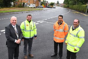 Cllr Mike Stathers, Jamie Husband from PBS (NE) Construction Ltd, Amarjeot Padda, senior engineer with East Riding of Yorkshire Council, and Trevor Brant, from consultants Aleon celebrate the completion of work in Howden.