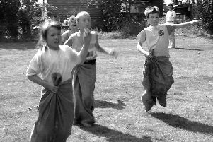 Taking part in a sack race back in 1990.