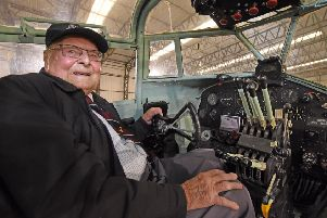Veteran pilot Flt Lt George Dunn DFC, aged 97, sits in the pilot's seat after 75 years at the Yorkshire Air Museum. Photo by David Harrison