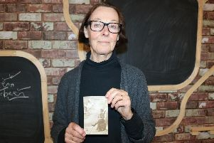 Kate Bayburt, Thomas Temprell's great niece, with her great uncle's postcard.