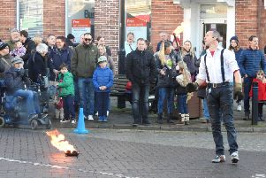 People enjoy the street entertainment at Pocklington's Christmas Festival.