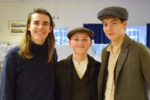 Former Pock School pupil George Jibson with students Thomas McDowell and Henry Hudson, who both played extras.
