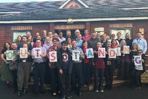 Staff at Derian House Childrens Hospice celebrate winning an outstanding rating from the Care Quality Commission