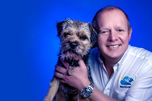 Kevin Matthews, owner of Barking Mad Pet Care Central Lancashire franchise, with his dog Derby
