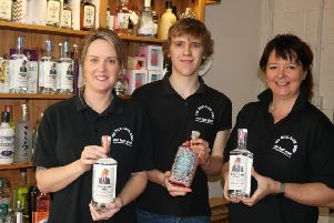 Keeley Dodds, Lloyd Garland and Jo Barnes at The Mile Farm Shop with a selection of gins available at the Gin and Therapy evening.