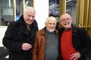 Artist and poet Michael Hildred (left) with friend David Seeger (centre) at the opening of the arts building.