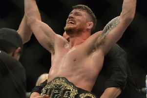 INGLEWOOD, CA - JUNE 04: Michael Bisping reacts after defeating Luke Rockhold in their Middleweight Title Bout at UFC 199 at The Forum on June 4, 2016 in Inglewood, California. (Photo by Jayne Kamin-Oncea/Getty Images)