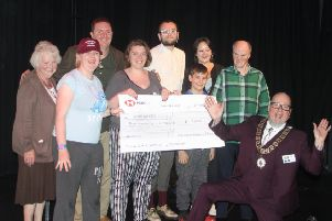 Town mayor Dean Hodgson presents a cheque to the Wolds Wonders .