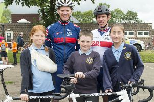 Paralympian Steve Bate (left) and his pilot Adam Duggleby, with Junior Travel Ambassadors (from left) Thea Moyler, Noah Jackson and Serena Clay.