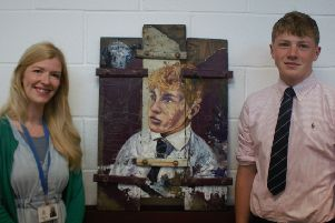 Danny Ratcliffe is pictured with his painting and art teacher Nikki Robertson.