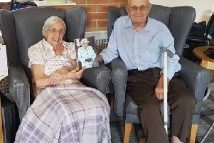 DEVOTED: Dorothy and John Oxley with their telegram from the Queen.