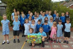 Bishop Wilton CE Primary School pupils with their masterpiece focusing on The Wolds.