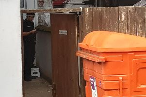 A police officer stood at the back of a hotel in Albert Road, Blackpool