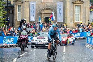 A Belgian cyclist passes Harrogate's Royal Pump Room Museum yesterday, Sunday during the Mixed Team Relay in the UCI World Championships 2019.