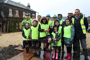 Pupils from Featherstone All Saints CofE Academy helped to bury a time capsule at Featherstone Hall