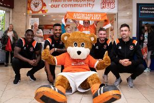 Sullay Kaiai, Curtis Tilt, James Husband and Ryan Hardie outside the new Blackpool FC store in August.