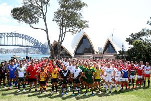 Competing nations pose for a group photo during the Rugby League World Nines at the Royal Botanic Gardens in Sydney, Australia. (Photo by Jason McCawley/Getty Images)