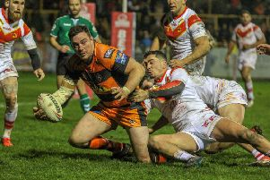 Grant Millington looks to get a pass away for Castleford Tigers against Catalans Dragons. Picture: Simon Hall