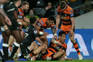 Castleford Tiger's Jesse Sene-Lefao (floor) celebrates scoring his sides second try.
