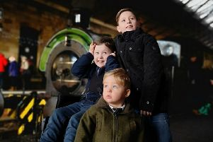 Eight-year-old Kai is pictured with brothers Finley, 9, and Theodore, 2.