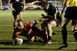 Liam Watts shrugs off a London Broncos player to dive over for his first-ever try for Castleford Tigers. Picture: Matthew Merrick