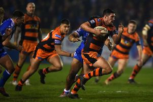 Chris Clarkson charges clear on his way to a try for Castleford Tigers against Hull KR. Picture: Matthew Merrick
