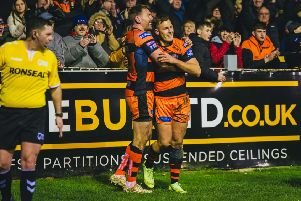 Greg Eden celebrates a try against Hull KR with Castleford Tigers skipper Michael Shenton. Picture: James Heaton