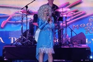 Kay Molyneaux as Dolly Parton, with fianc Joe Curtis on drums