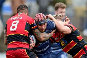 Feathersone Rovers' Luke Cooper is tackled by Dewsbury's Jode Sheriffe and Kyle Trout. Picture: Paul Butterfield