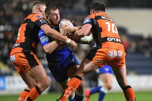 Leeds Rhinos Cameron Smith is tackled by Castleford Tigers' Liam Watts and Grant Millington.' ('Picture: Jonathan Gawthorpe)