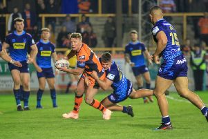 Adam Milner, takes on the Wigan Warriors defence. Picture: Simon Hall