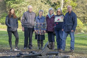 Up in flames: Rachel Riley with members of the Friends of Friarwood Valley Gardens, who funded the installation of the bench two years ago.