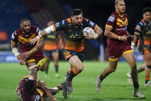 Castleford's Matt Cook in action at Huddersfield.