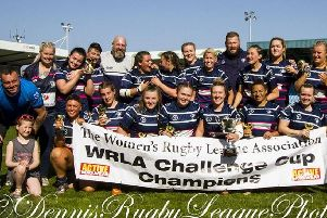 Featherstone Lionesses celebrate winning the WRLA Challenge Cup final. Picture: Dennis Whipp