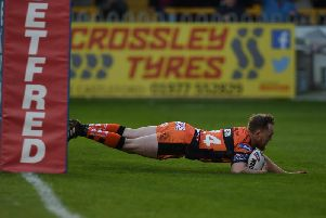 Cory Aston dives over for a try for Castleford Tigers against Warrington Wolves. Picture: Matthew Merrick