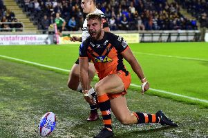 Mike McMeeken celebrates a try in a previous game at Hull.