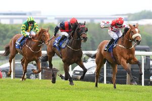 Regular Income, ridden by Toby Eley, forges ahead on the run-in to win the Doncaster Equine College Handicap.