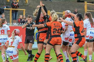 Emma Lumley celebrates her try for Castleford Tigers Women against St Helens. Picture: Simon Hall
