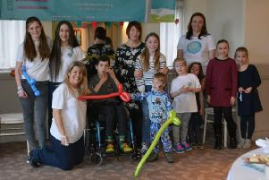 Petrina Sill, front left, and some volunteers are pictured with some of the families the Eden Dora Trust has helped.
