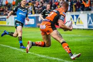 Greg Minikin goes over for a first half try for Castleford Tigers against Hull. Picture: James Heaton