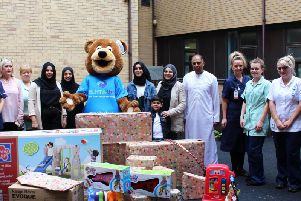 Staff with the donated toys