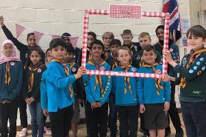 Members of Heckmondwike Scout Group show off their More In Common badges.