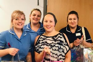 Sherine Hampshire presents the luxury packs to chemotheraphy nurses at Pinderfields Hospital.