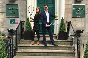 Game, set and match - Natalie Ruecroft cluster sales manager and Adam Green general manager at Hotel du Vin in Harrogate preparing for the courtyard Wimbledon event.