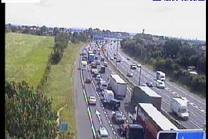 More than two miles of traffic has built up due to a lane closure on the M62. Picture: Highways England