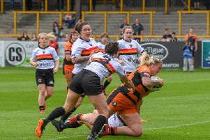 Rhiannion Marshall, who scored two tries for Castleford Tigers Women against her former club, Leeds Rhinos.