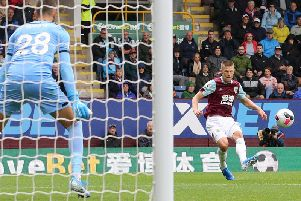 Burnley's Johann Berg Gudmundsson scores his side's third goal past Southampton's Angus Gunn